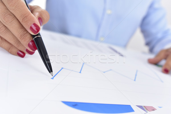 businesswoman with a chart with an upward trend Stock photo © nito