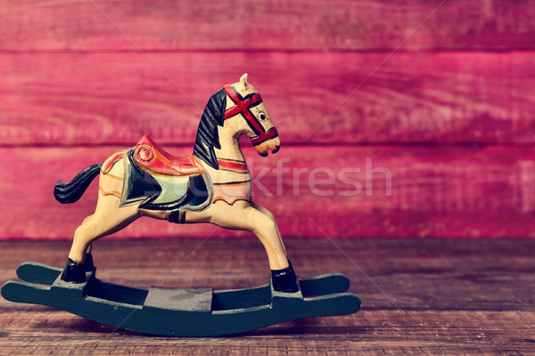 old toy horse on a wooden surface Stock photo © nito