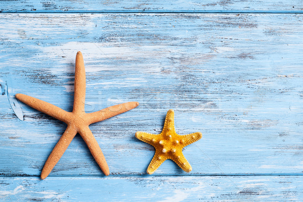 starfishes on a blue rustic wooden table Stock photo © nito