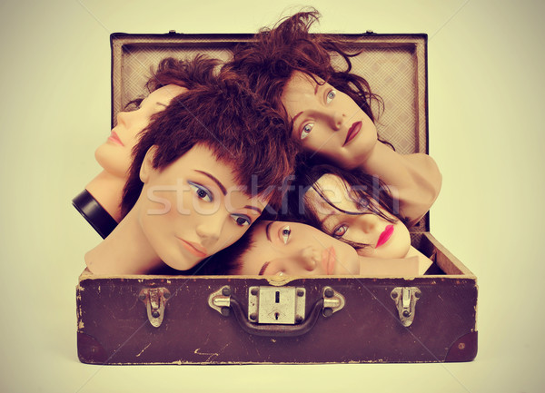 mannequin heads in an old suitcase Stock photo © nito
