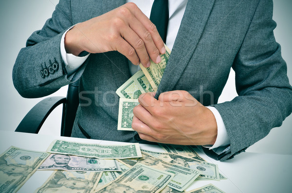man in suit getting dollar bills in his jacket Stock photo © nito