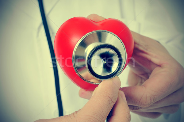 doctor auscultating a heart with a stethoscope, with a retro eff Stock photo © nito