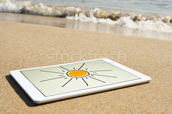 Nap rajzolt tabletta homok tengerpart táblagép Stock fotó © nito