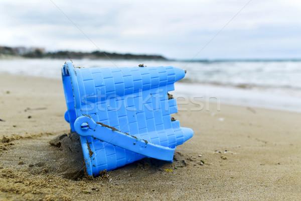 Terkedilmiş oyuncak kova plaj mavi Stok fotoğraf © nito