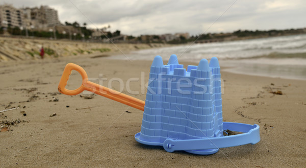abandoned toy shovel and bucket on the beach Stock photo © nito