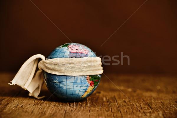 piece of cloth tied around a terrestrial globe Stock photo © nito