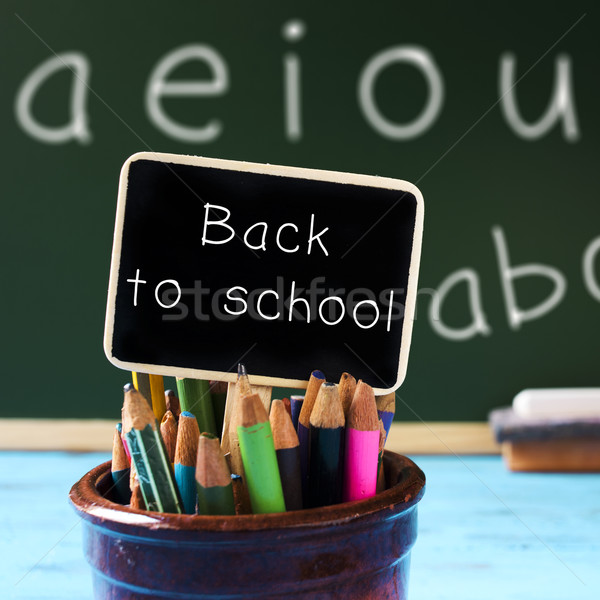text back to school on a blackboard Stock photo © nito