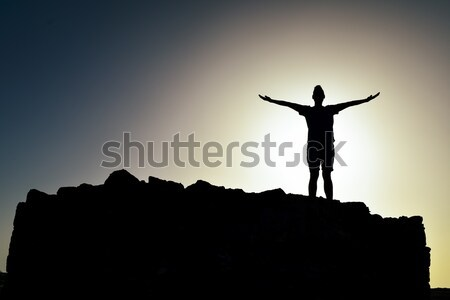 silhouette of a man with open arms Stock photo © nito