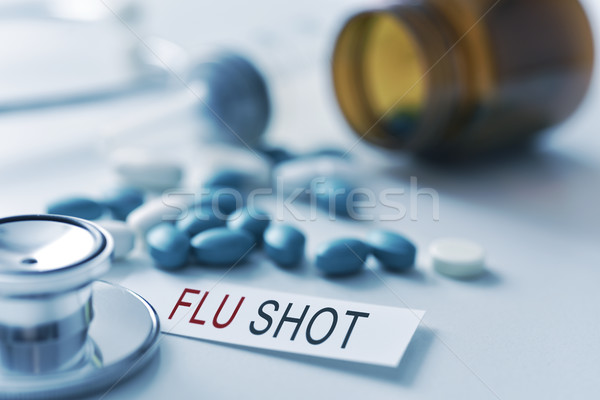 stethoscope, pills and text flu shot Stock photo © nito