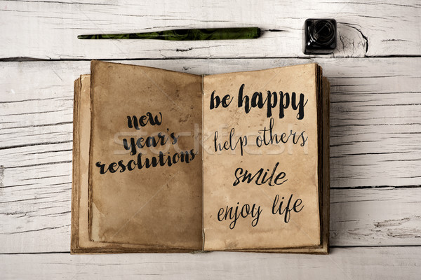 new years resolutions in a yellowish notebook Stock photo © nito