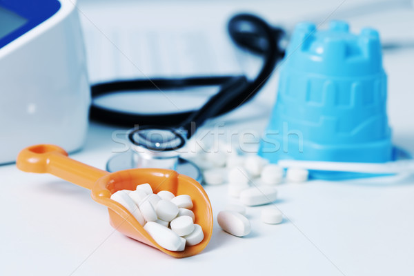 beach shovel and pills on the doctors desk Stock photo © nito