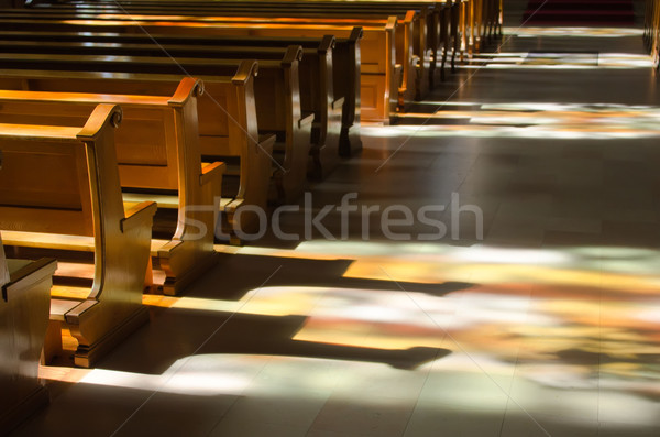 reflection of the stained glass windows inside a church Stock photo © njaj