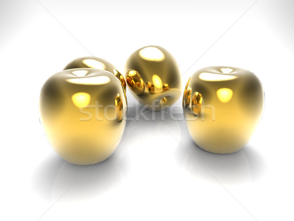 Stock photo: apples  in gold on a gray background