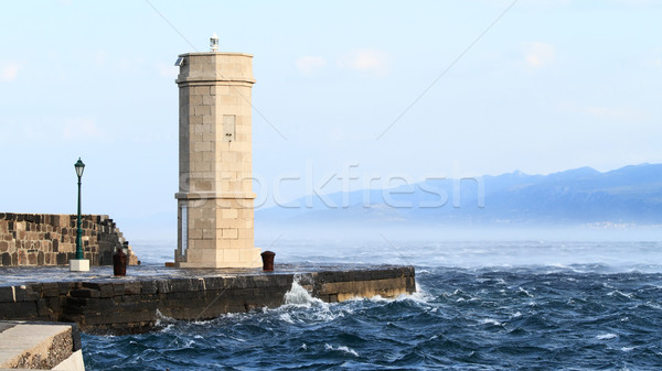 Picture represents the lighthouse while blowing strong wind Stock photo © Nneirda
