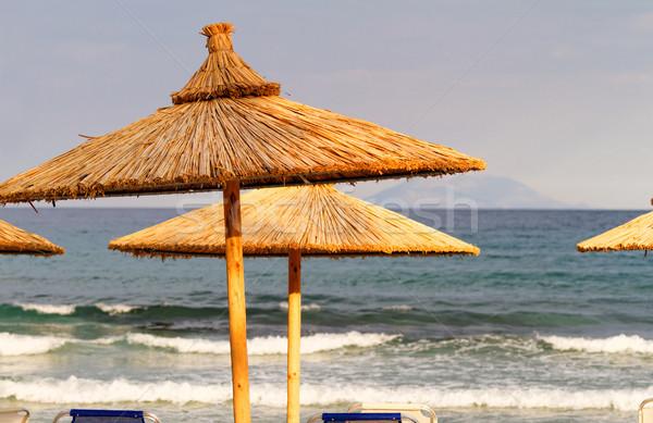 Sombrilla foto playa Croacia mar azul Foto stock © Nneirda