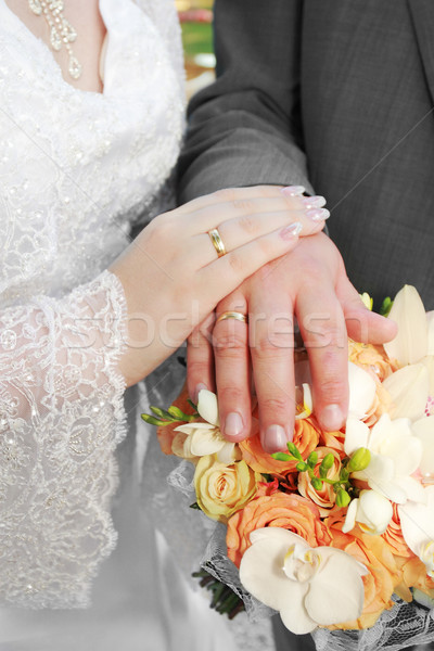 Wedding: hands, rings and bouquet Stock photo © Nneirda