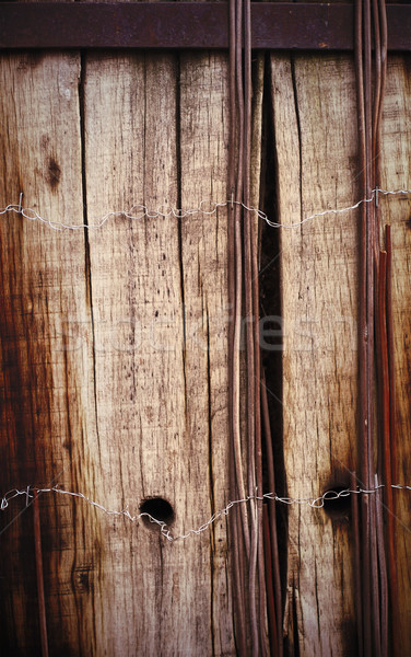 Old board fence with rusty nails and a barbed wire Stock photo © Nneirda