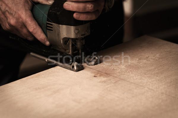 Zag foto man werken hand bouw Stockfoto © Nneirda