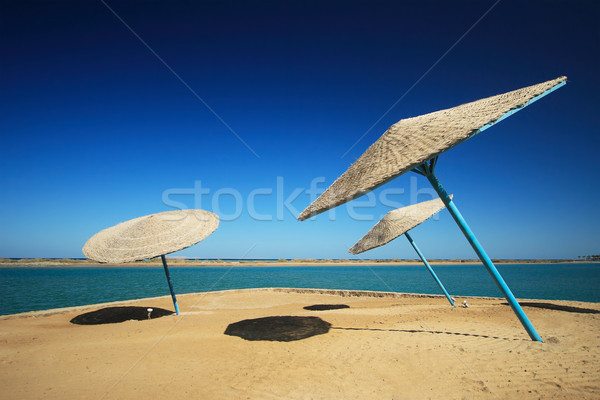 Wicker Beach Umbrella Stock photo © Nneirda