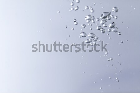 Air bubbles in the water Stock photo © Nneirda