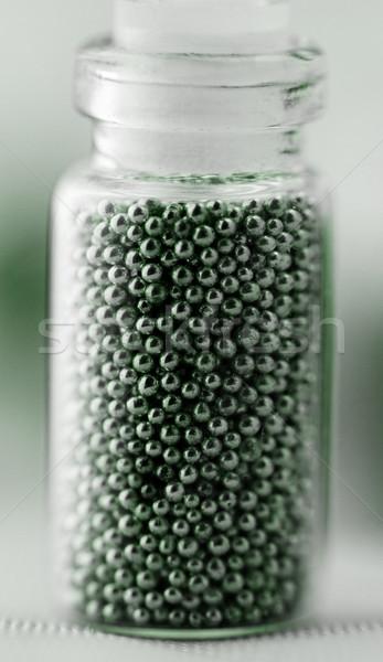 Perlas unas vidrio fondo verde botella Foto stock © Nneirda