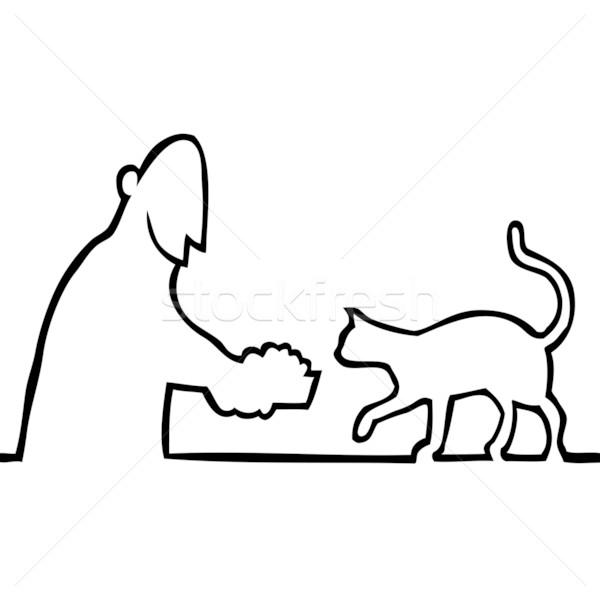 Guy feeding a cat Stock photo © Noedelhap