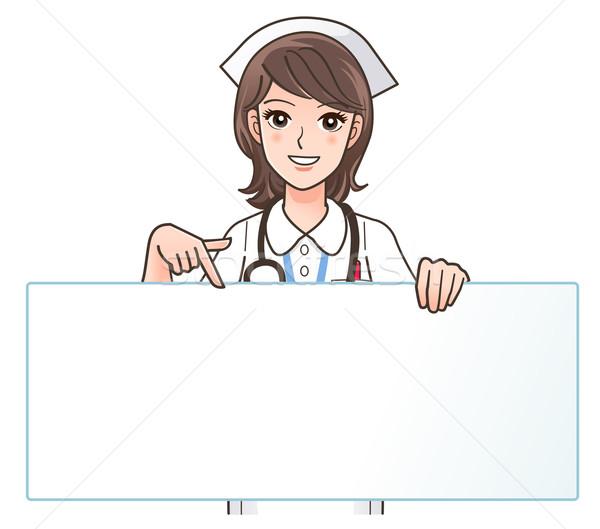 Cute улыбаясь медсестры указывая совета копия пространства Сток-фото © norwayblue