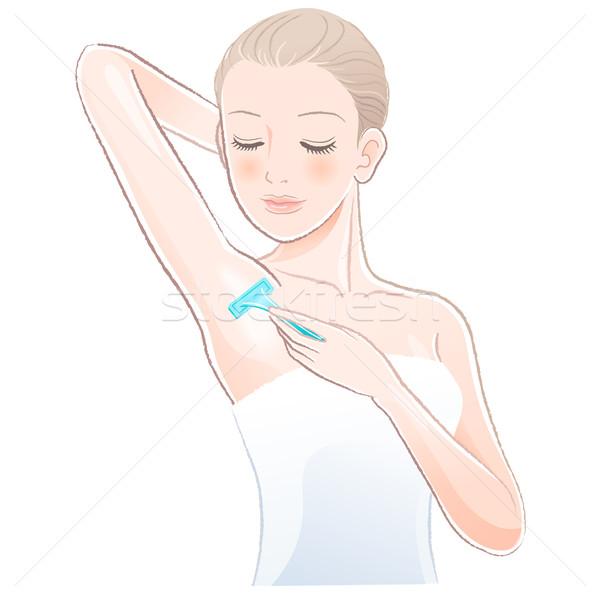 Portrait of pretty woman shaving underarm with razor Stock photo © norwayblue