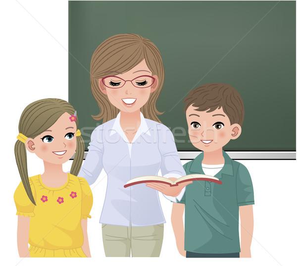 Szkoły nauczyciel czytania uczniowie dziewczyna chłopca Zdjęcia stock © norwayblue