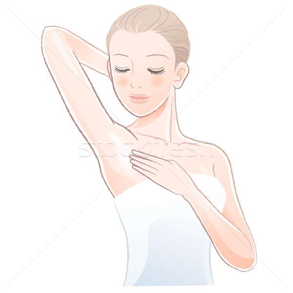 Pretty female gently touching and looking her clean armpit Stock photo © norwayblue