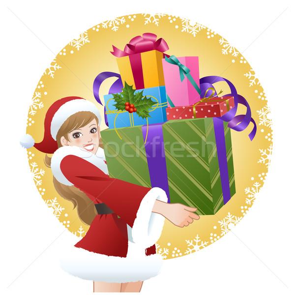 Beautiful woman wearing Santa costume holding gifts Stock photo © norwayblue