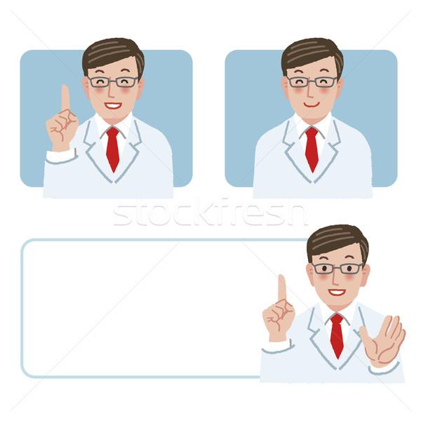 Lekarza uśmiechnięty wskazując w górę szczęśliwy Zdjęcia stock © norwayblue