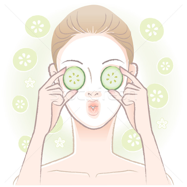 Young woman with facial mask  applying sliced cucumber on her ey Stock photo © norwayblue