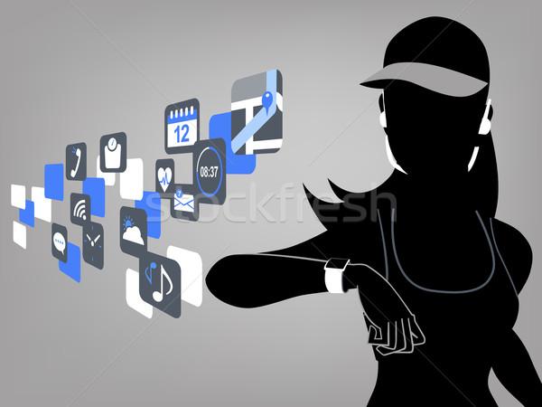 Stok fotoğraf: Fitness · woman · akıllı · izlemek · bakıyor · dokunmatik · ekran