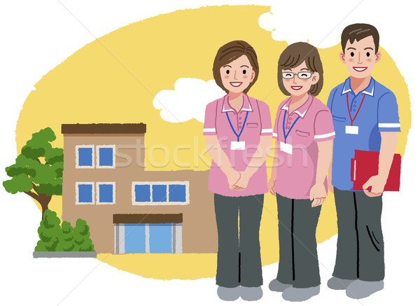 Smiling caregivers in pink uniform and nursing house Stock photo © norwayblue