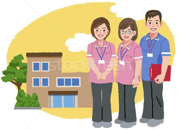 Sonriendo rosa uniforme casa tres Foto stock © norwayblue