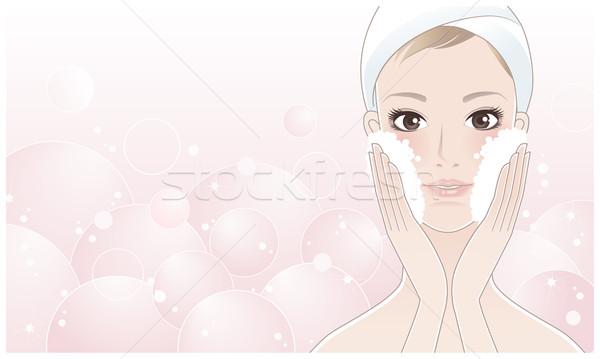 Beautiful young woman washing her face Stock photo © norwayblue