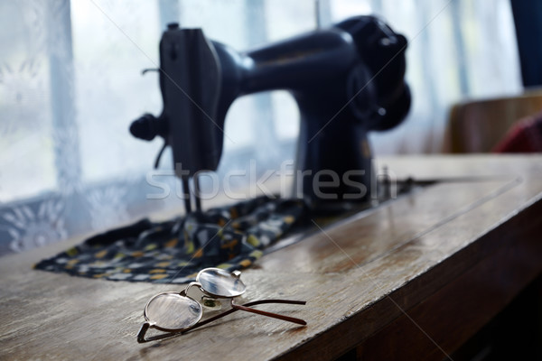 Glasses and sewing machine Stock photo © Novic