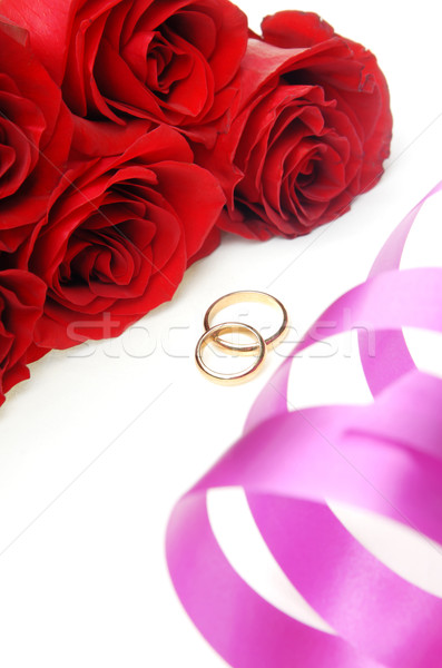 Holiday ribbon and wedding rings with flowers Stock photo © Novic