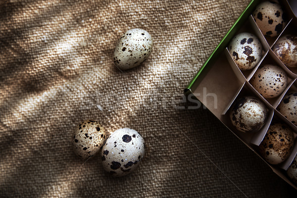 Quail eggs in carton box on a sackcloth Stock photo © Novic