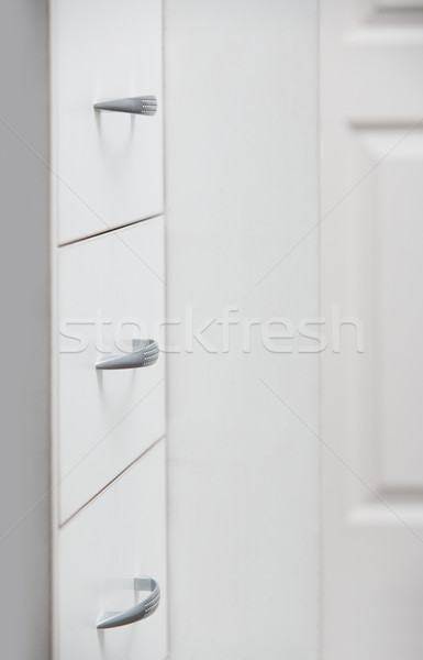 Cabinet with sliding trays and chrome handles Stock photo © Novic
