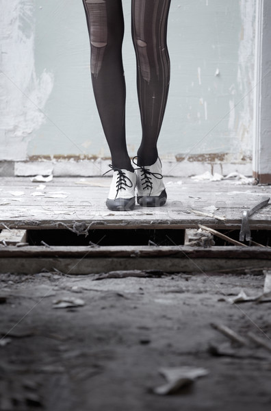 Human legs in stylish shoes standing in the ruined dirty room Stock photo © Novic