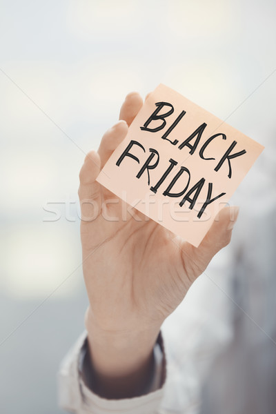 Kobieta przyczepny Uwaga black friday tekst Zdjęcia stock © Novic