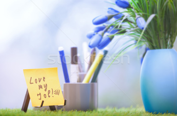 Adhesive note with Love my job text at green office Stock photo © Novic