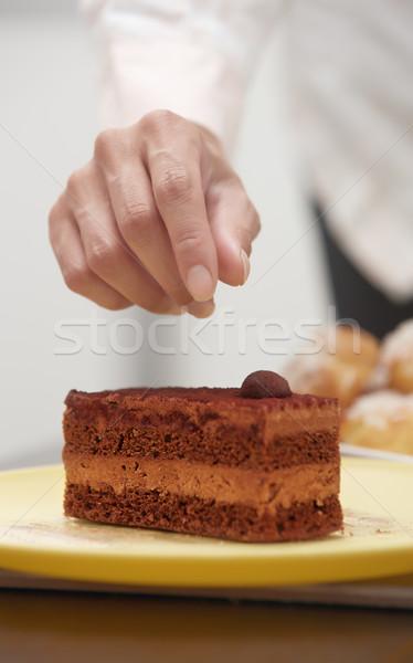 Woman confectioner preparing cake Stock photo © Novic