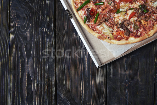 Pizza on a wooden table Stock photo © Novic