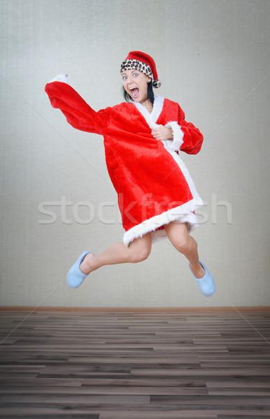 Gek springen kerstman dame binnenshuis Stockfoto © Novic