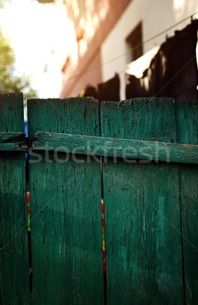 Green wooden fence in residential district Stock photo © Novic