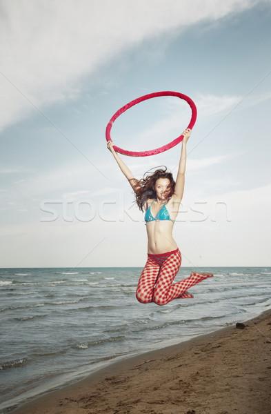 Jump with hula hoop Stock photo © Novic