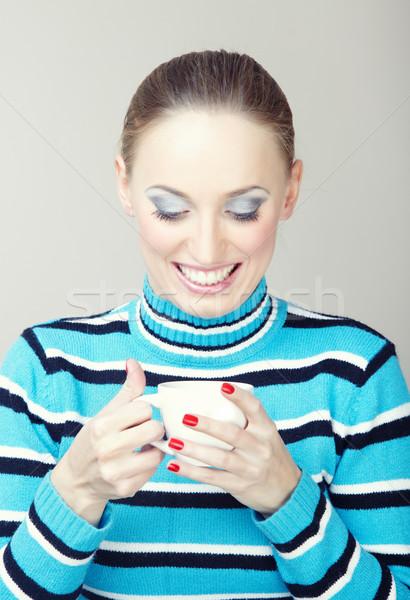 чай улыбающаяся женщина полосатый свитер Сток-фото © Novic